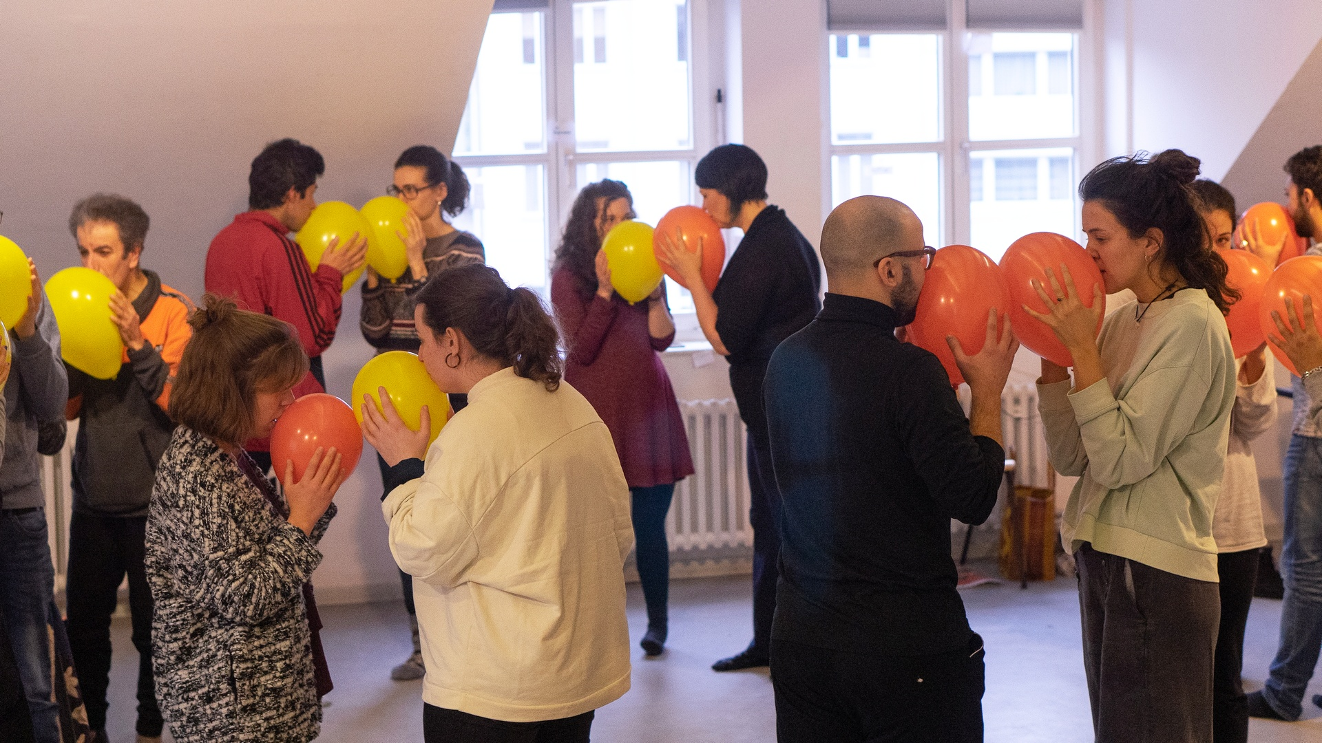 People doing a group exercise with balloons